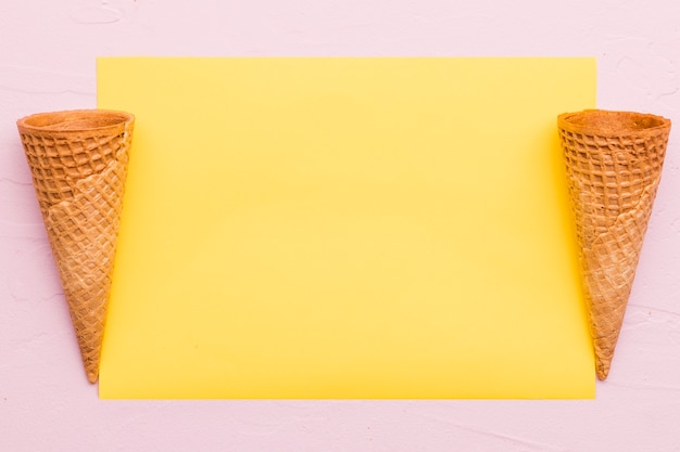 Empty waffle cones on different color background