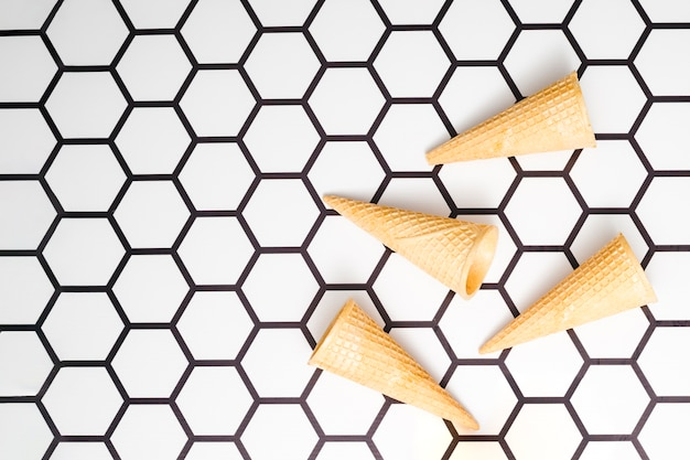 Empty waffle cones on hexagon background
