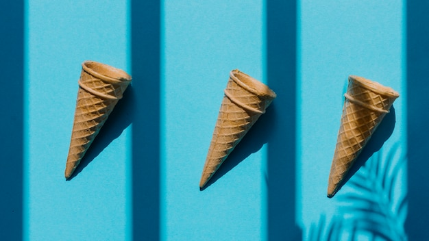 Empty waffle cones in row on table