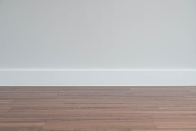 Empty wall with a wooden floor below