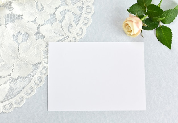 Empty wedding invitation, greeting card mockup, rose and white laces