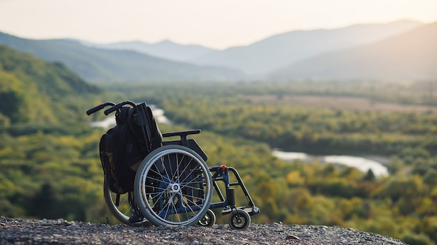 Empty wheelchair on the mountains at sunset