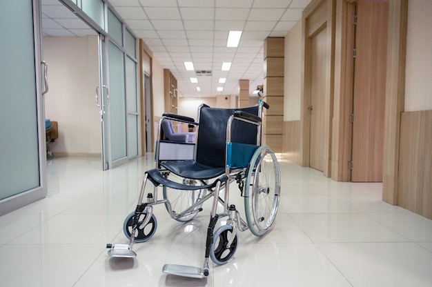 Empty wheelchair parked on corridor in the hospital