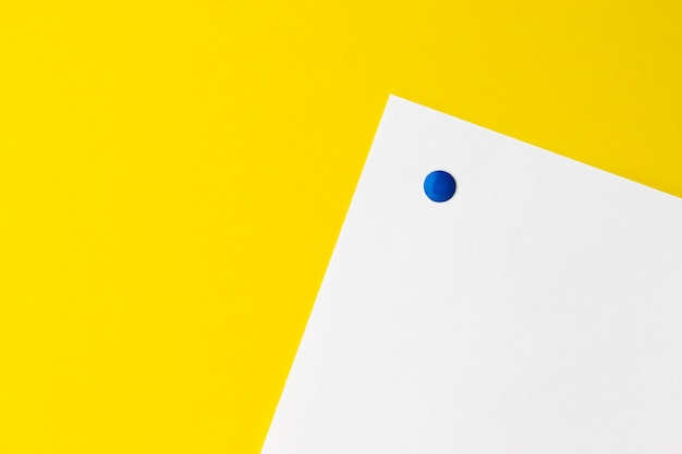 Empty white card is pinned to yellow background