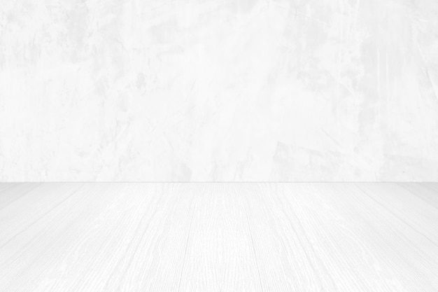 Empty white cement wall and wood floor background