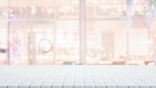 Empty white ceramic mosaic table top and blurred bokeh cafe and restaurant background.