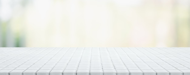 Empty white ceramic mosaic table top and blurred bokeh cafe and restaurant banner background