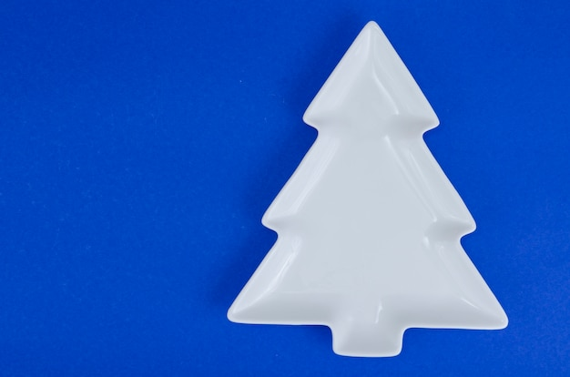 Empty white christmas tree plate for table christmas festive setting.