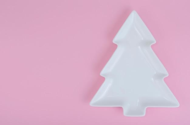 Empty white christmas tree plate for table christmas festive setting.