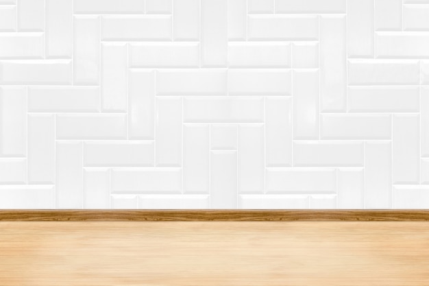 Empty white clean ceramic tile wall and wood floor background
