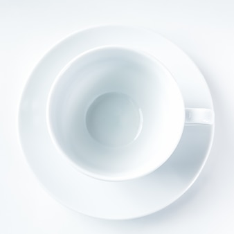Empty white coffee cup on white background