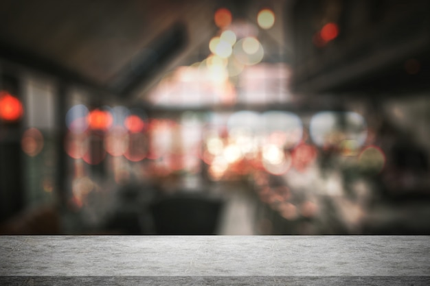 Empty white concrete table in front with blur background of bar cafe and restaurant.