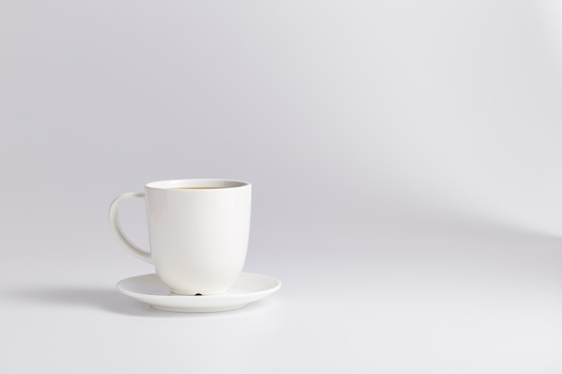Empty white cup isolated on white