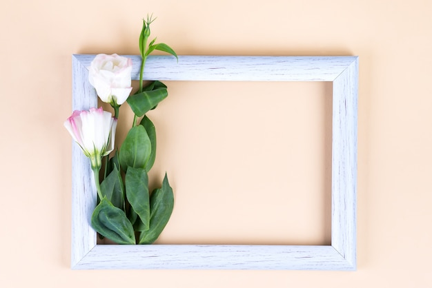 Empty white frame and flowers