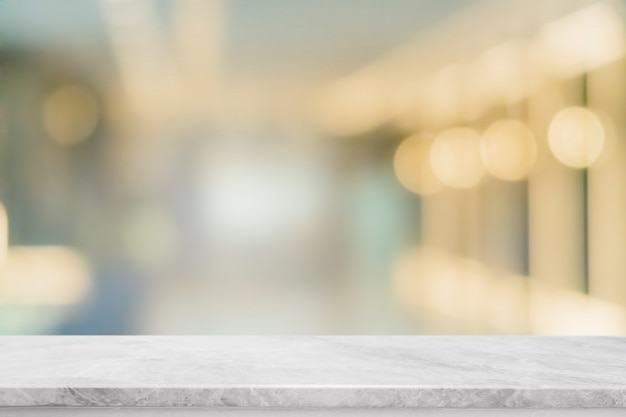 Empty white marble stone table top and blur glass window interior restaurant banner mock up abstract background