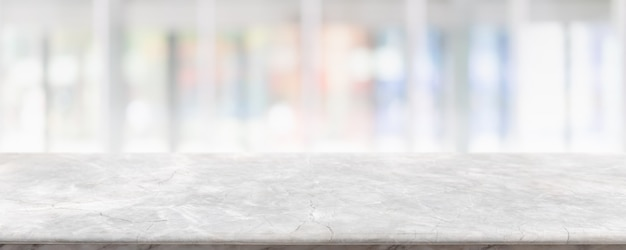 Empty white marble stone table top and blur glass window interior
