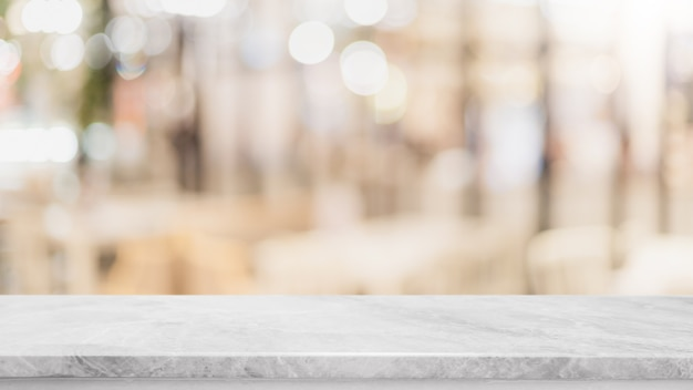 Empty white marble stone table top and blur glass window wall  background