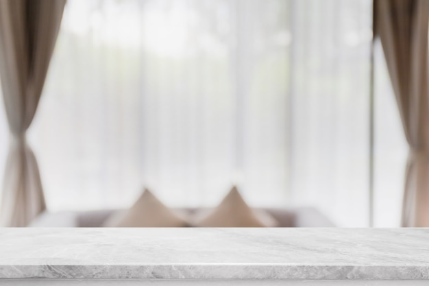 Empty white marble stone table top and blurred at home interior with curtain window