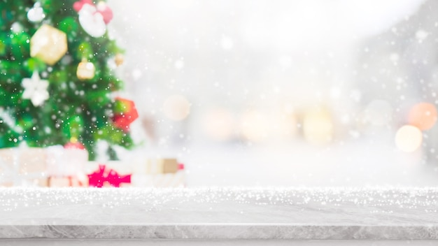 Empty white marble stone table top with bokeh light on blurred christmas tree banner