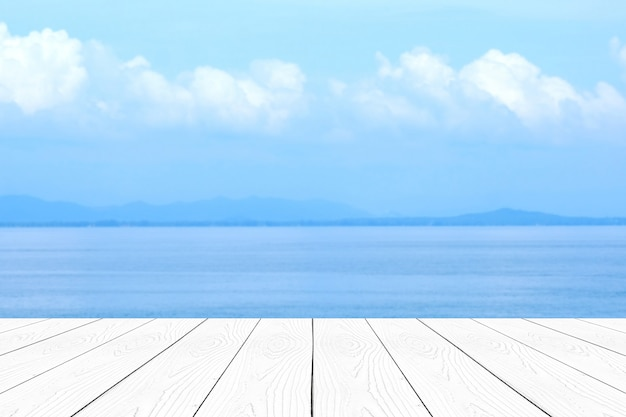 Empty white marble table over blur blue sea and sky in summer