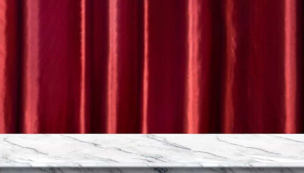 Empty white marble table and blurred vivid red luxury curtain background