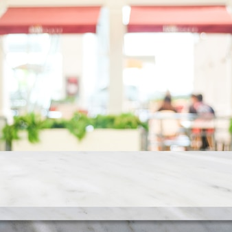 Empty white marble table over blur restaurant background