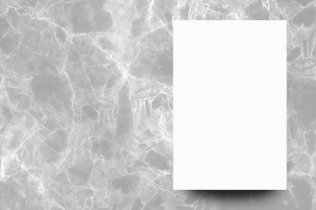 Empty white paper sheet on grey marble background