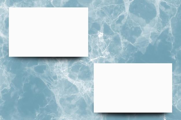 Empty white paper sheet on indigo marble background