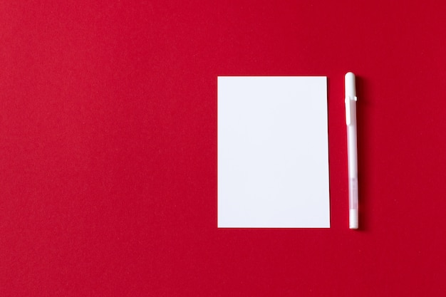 Empty white paper sheet isolated on red background