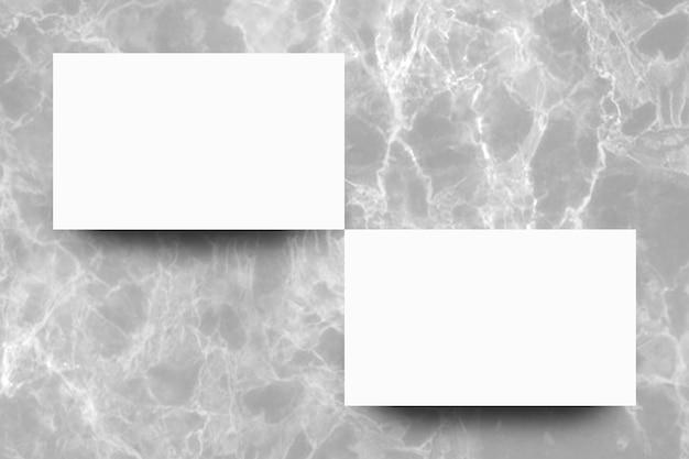 灰色の大理石の背景に空の白い紙のシート