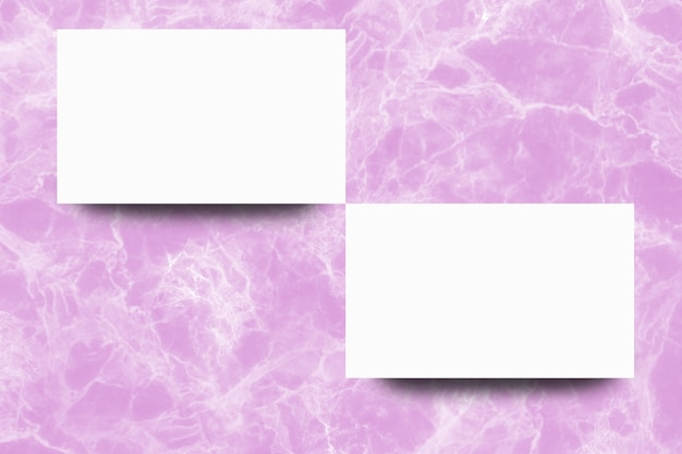 Empty white paper sheet on pink marble background