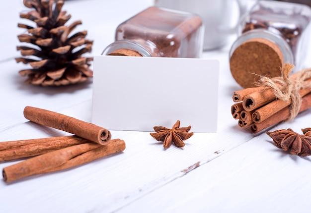 Empty white paper tag and cinnamon sticks