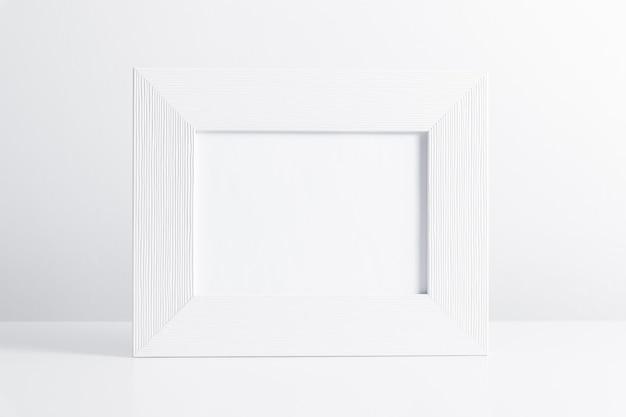 Empty white photo frame isolated on white background