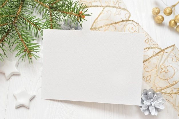 Empty white sheet of paper on a white christmas background