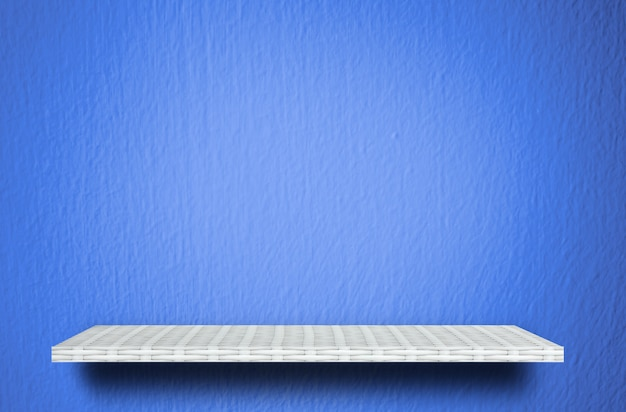 Empty white shelf on blue cement background for product display