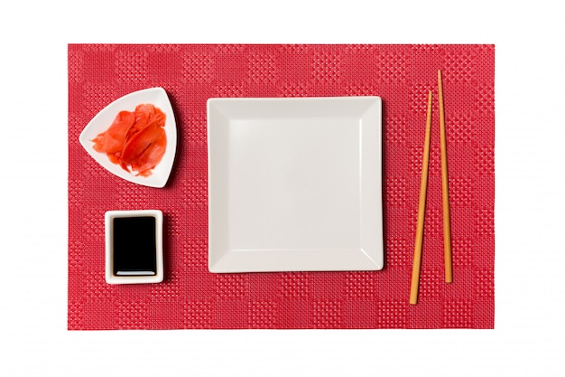 Empty white square plate with chopsticks for sushi