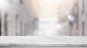 Empty white stone marble table top and blurred abstract background from shopping mall back