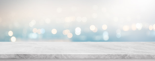 Empty white stone marble table top and blurred abstract bokeh light banner background.