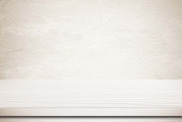 Empty white wood table over grunge cement wall background