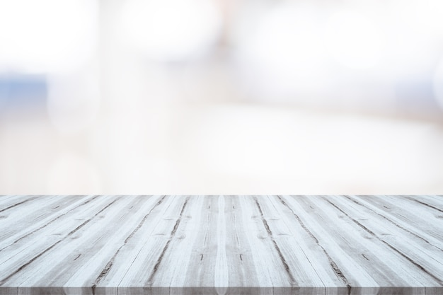 Empty white wood table top on blurred background,space for montage show products