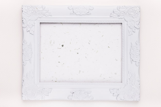 An empty white wooden frame on background