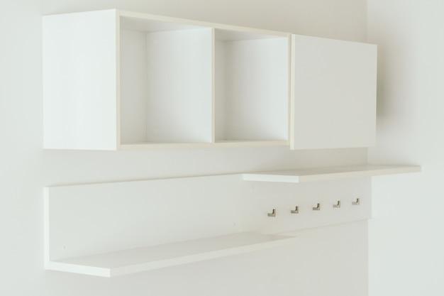 Empty white wooden shelves