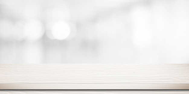 Empty white wooden table over blurred store with bokeh background