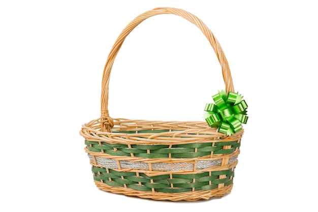 Empty wicker basket with ribbon isolated on white