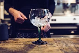 Empty wine glass with ice