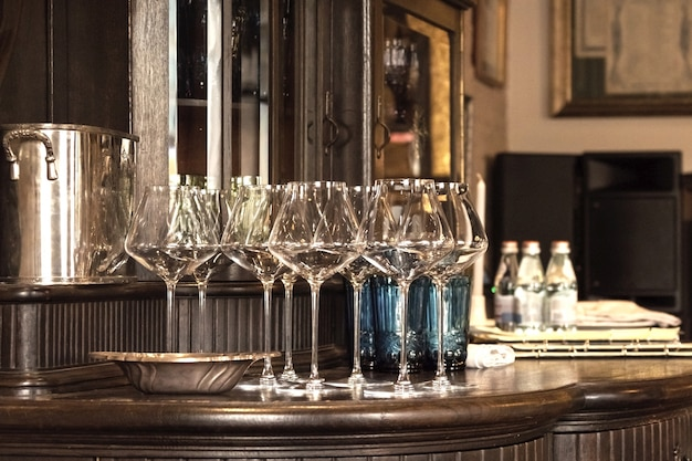 Empty wine glasses on the table. glasses of elite wine on the bar in a dark interior.