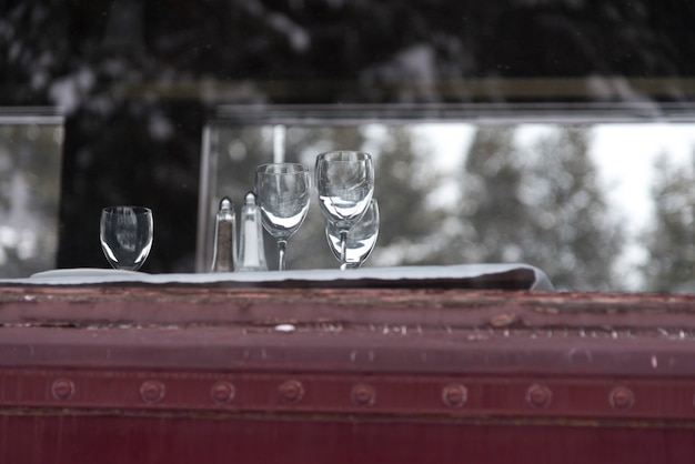 Empty wineglasses as seen through a window of the canadian pacific train, banff national park, alber