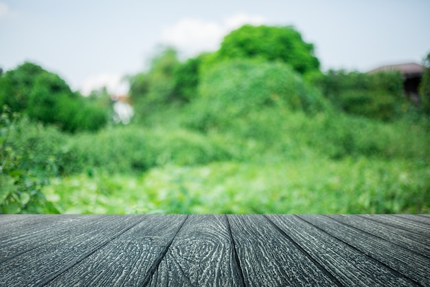 Empty wood floor with lanscape background blurred