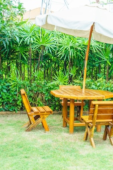 Empty wood outdoor patio table and chair in home garden