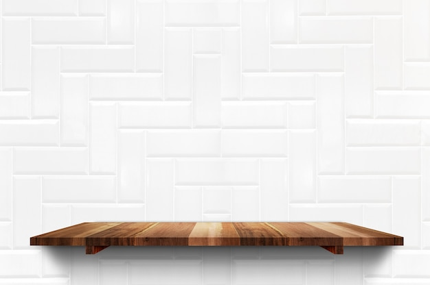 Empty wood plank shelf at white ceramic tile wall background